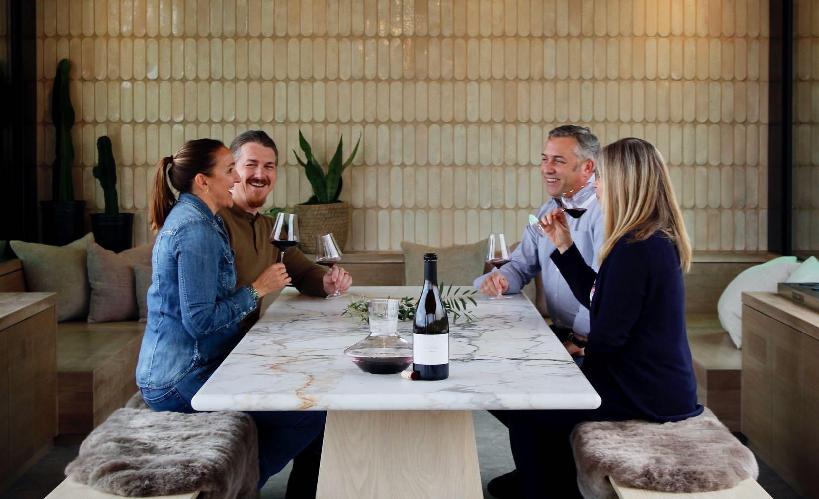 Friends drinking wine on the terrace